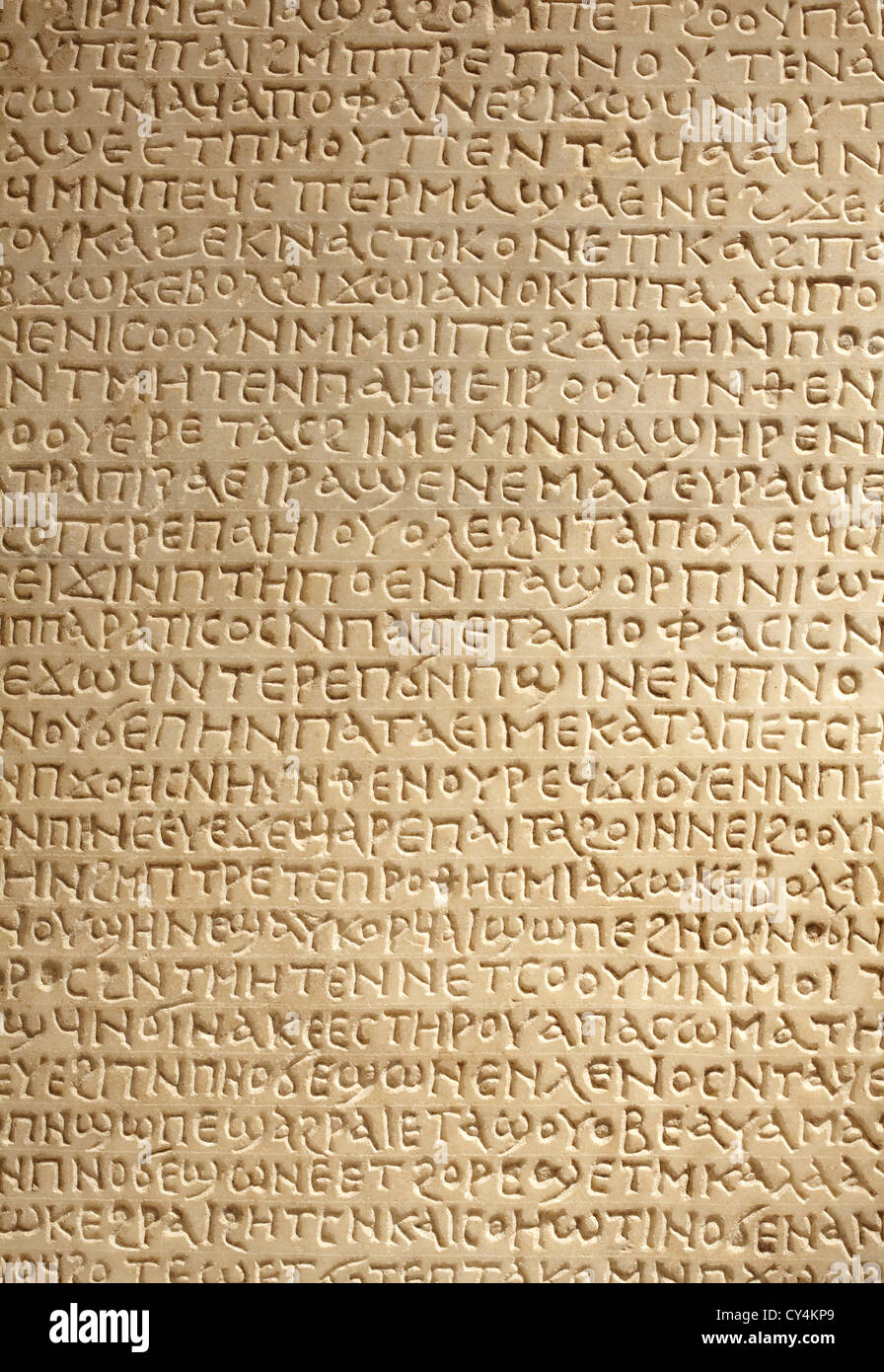 Ancient greek writing on stone background - Stock Image