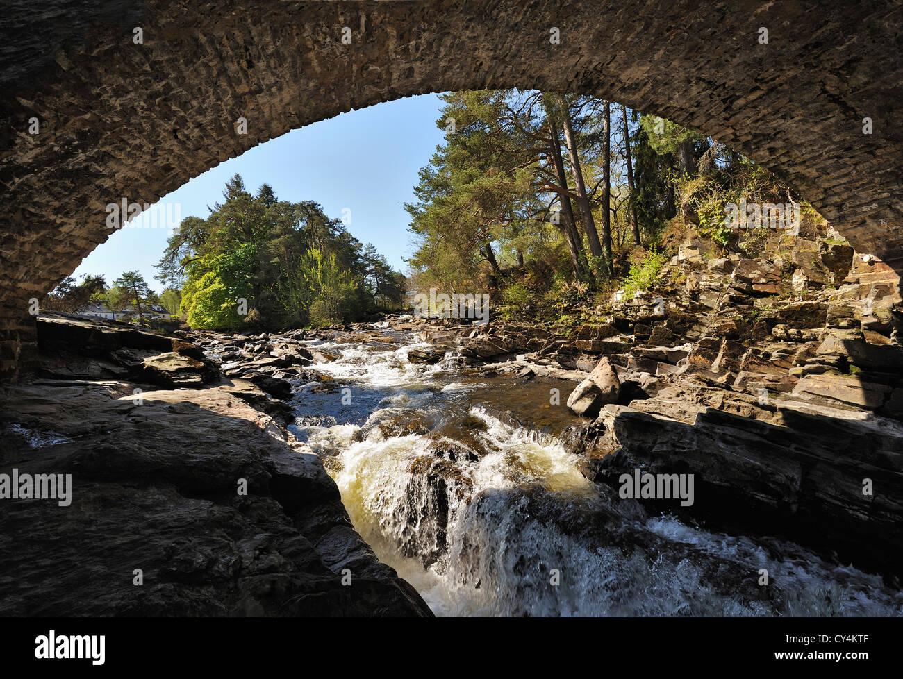 Below the arches of the bridge at the Falls of Dochart, Killin, Perthshire, Scotland, UK - Stock Image