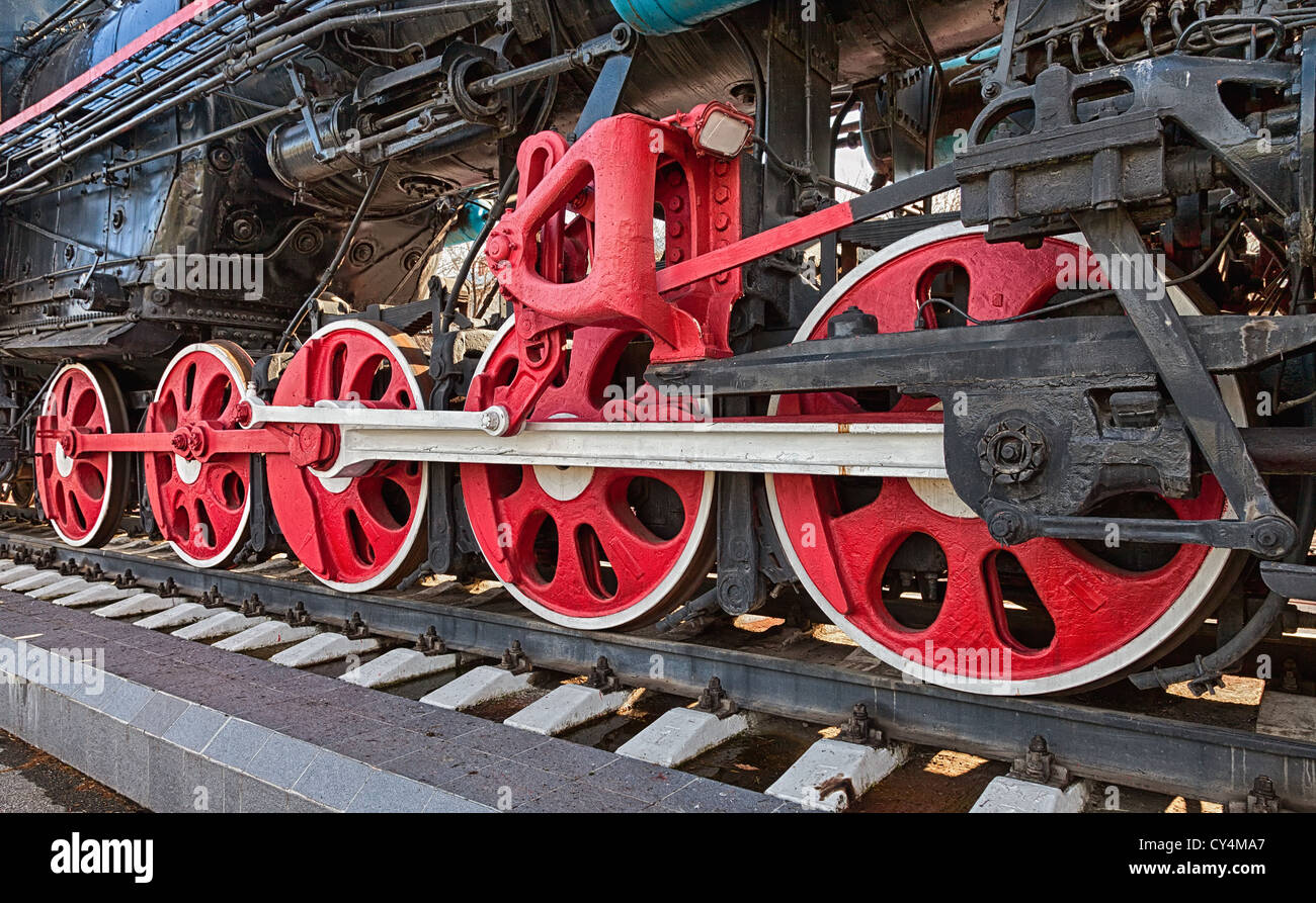 Old steam locomotive engine wheel and rods details Stock Photo