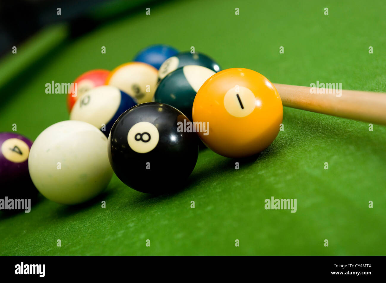Shooting a game of poor or billiards - Stock Image