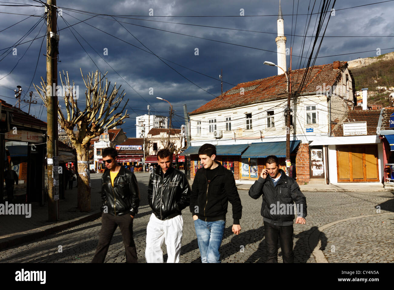 4 young Kosovar young men in a Prizren street, Kosovo Stock Photo