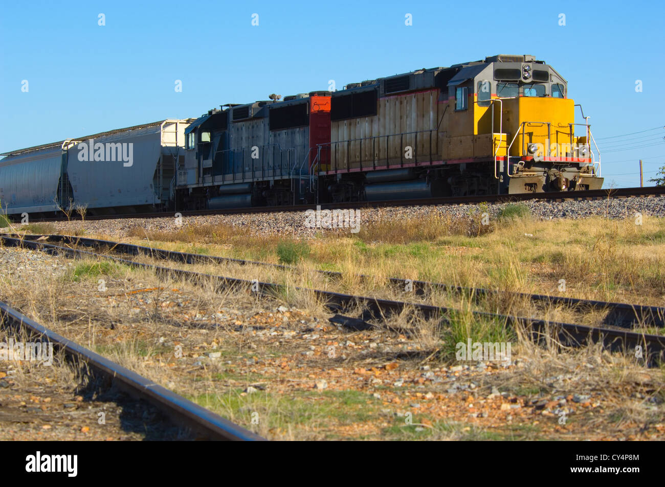 train with yellow engine on connection tracks - Stock Image