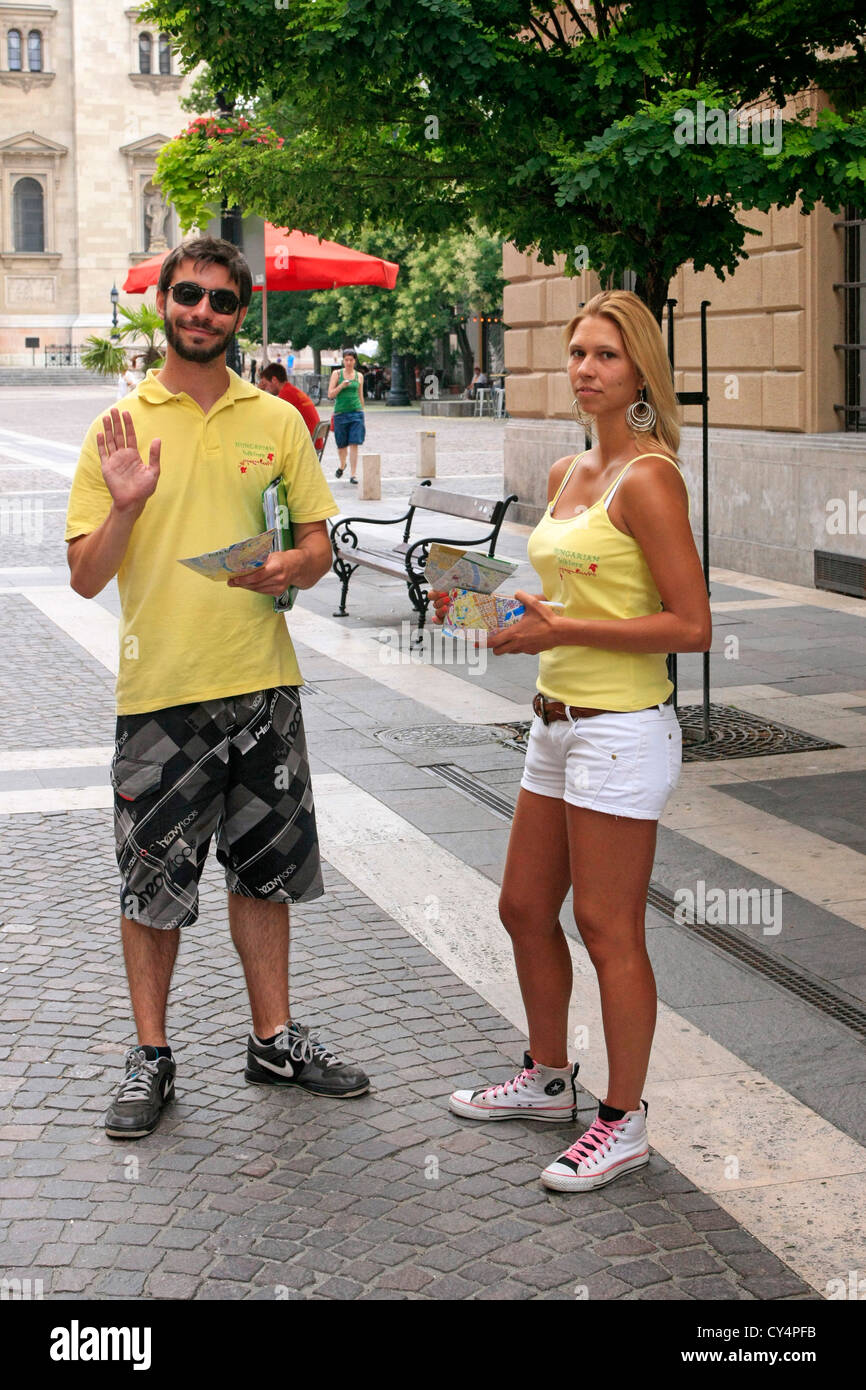 Ticket sellers for tourist bus rides in Budapest - Stock Image