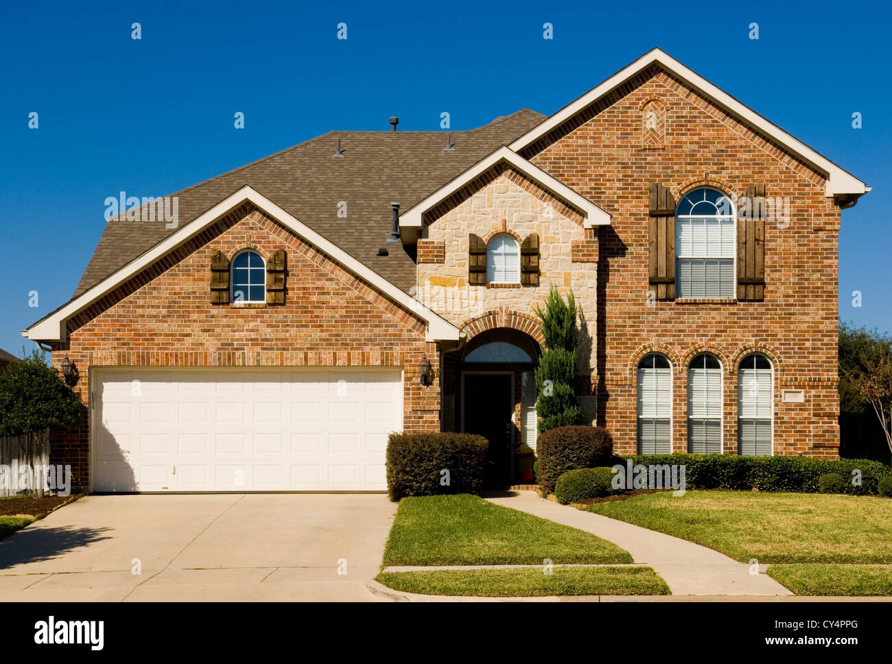 Two story home garage stock photos two story home garage for Beautiful two story homes
