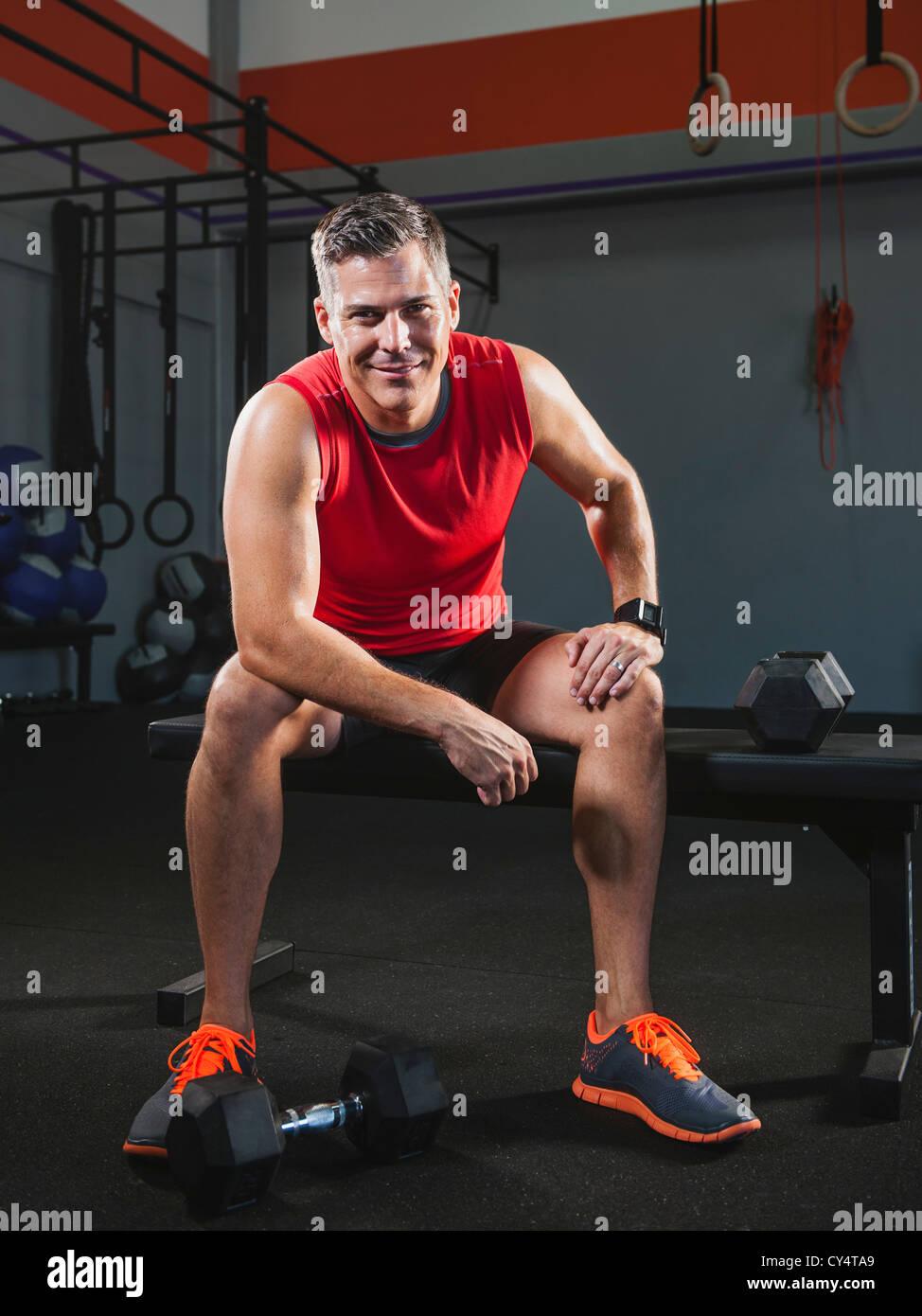 USA, California, Laguna Niguel, Mature man taking break from exercising - Stock Image