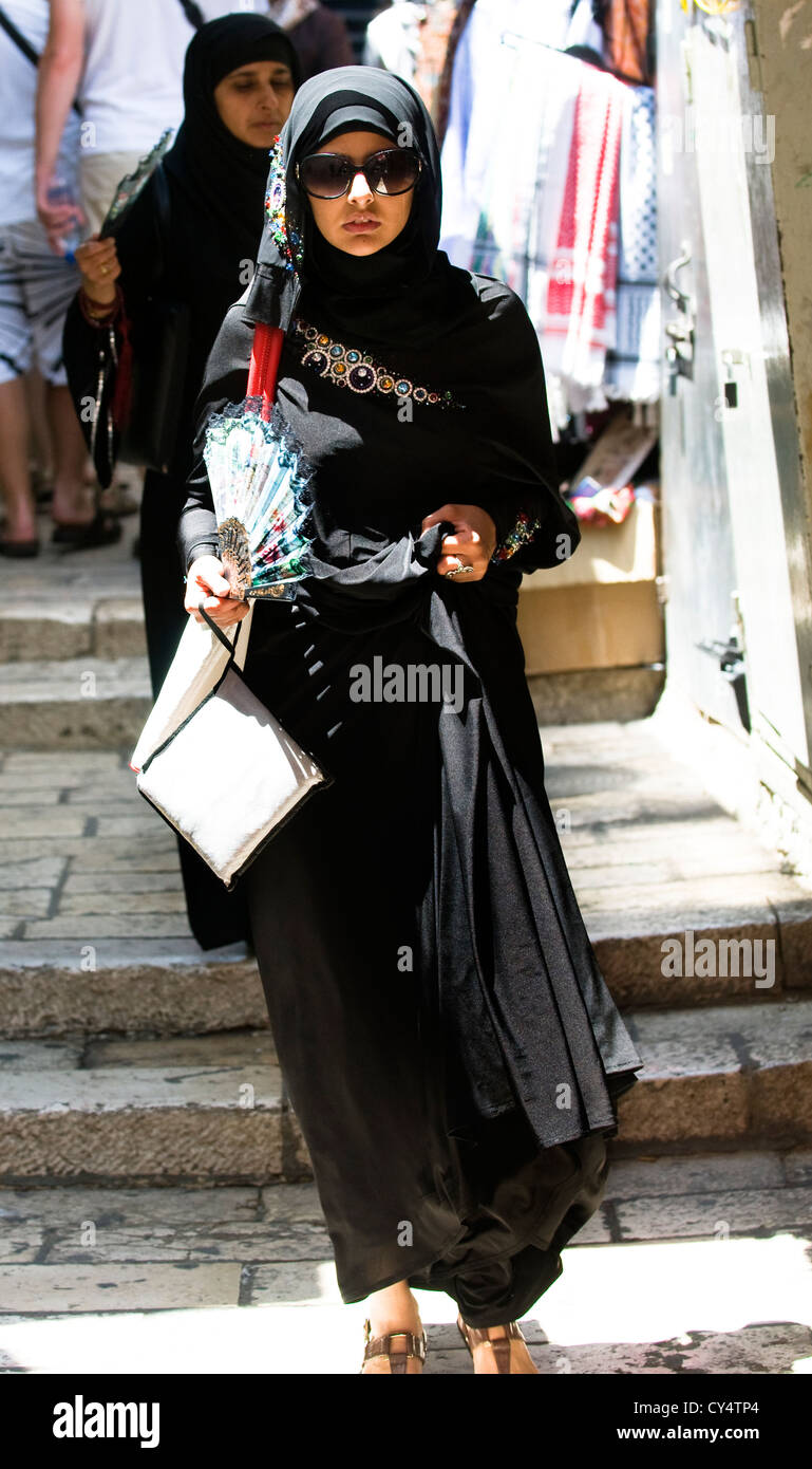 A Muslim Palestinian woman walking to the Al Aqsa mosque for the Friday prayers during the holy month of Ramadan. - Stock Image