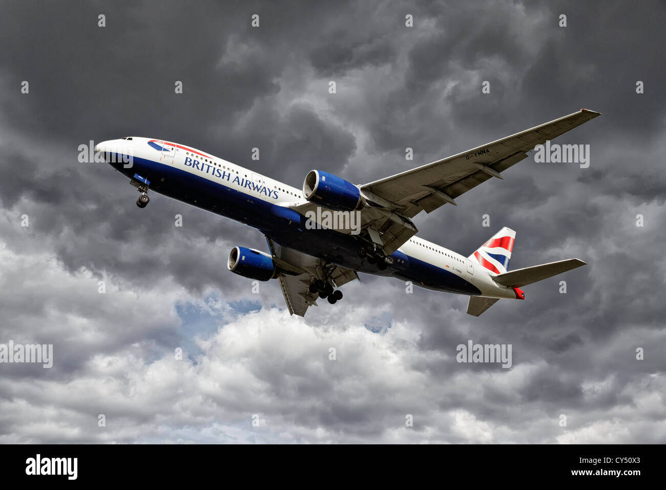 A Boeing B777 of British Airways on final approach - Stock Image