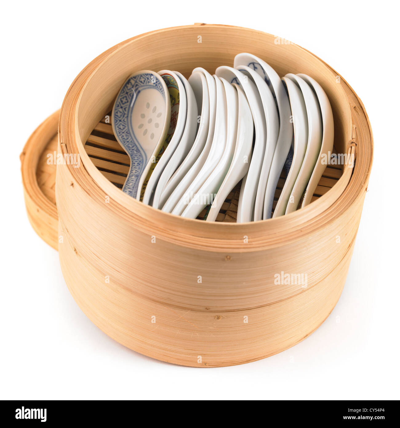 Chinese bamboo rice steamer used for storing oriental soup spoons - Stock Image