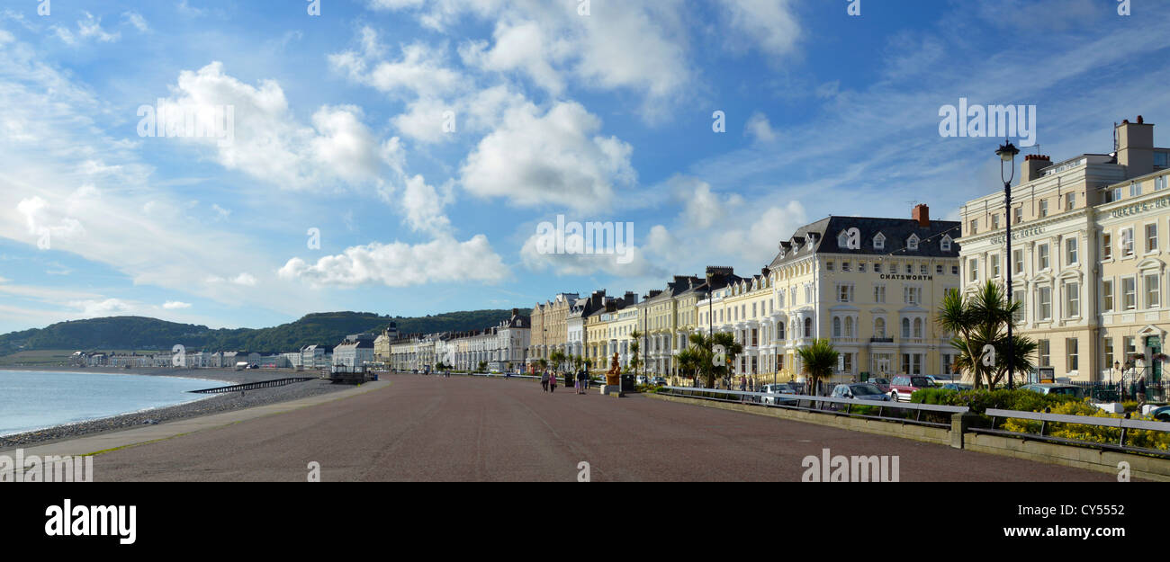 Llandudno Wales The broad sweep of Llandudno Promenade and seafront hotels early morning summertime - Stock Image