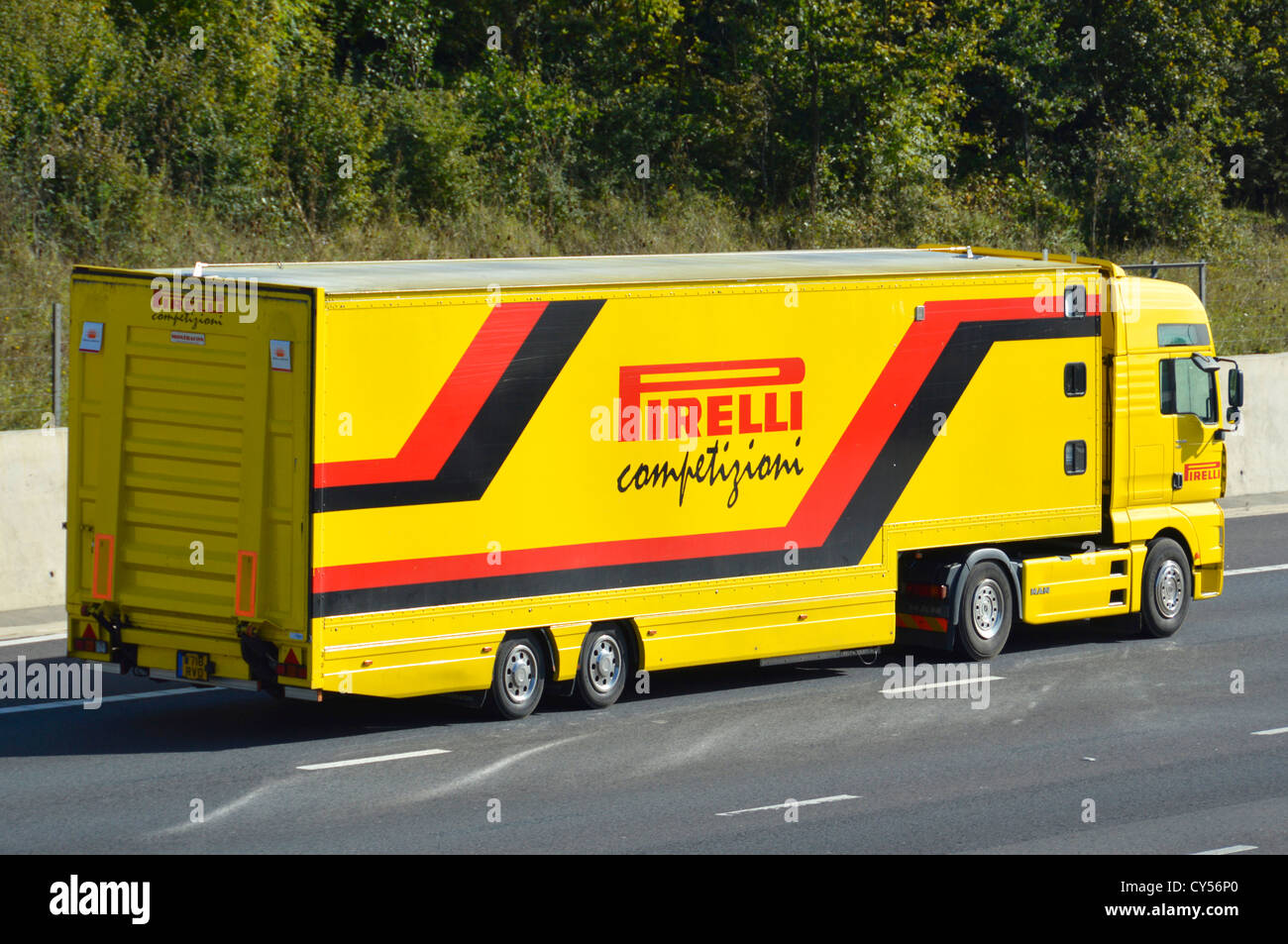 Pirelli articulated competition support lorry and trailer on motorway - Stock Image