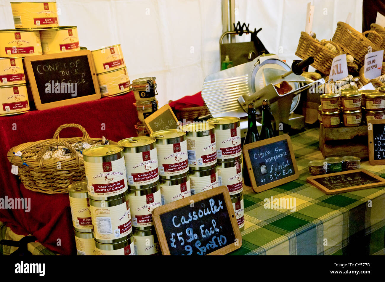 Tins of cassoulet for sale on continental market stall York North Yorkshire England UK United Kingdom GB Great Britain - Stock Image