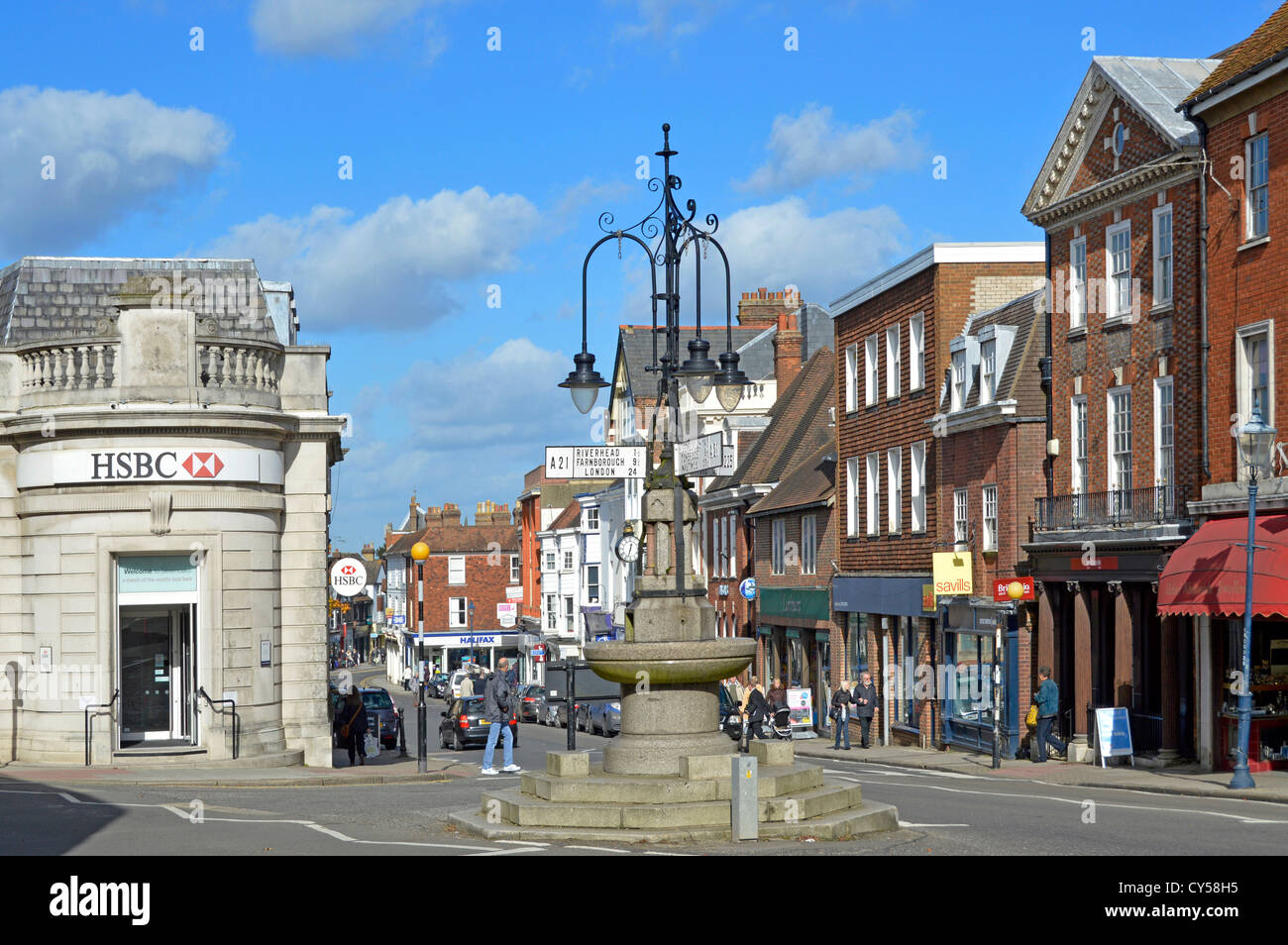 Fountain and signposts at junction of London Road and Sevenoaks shopping High Street with HSBC bank branch Kent - Stock Image