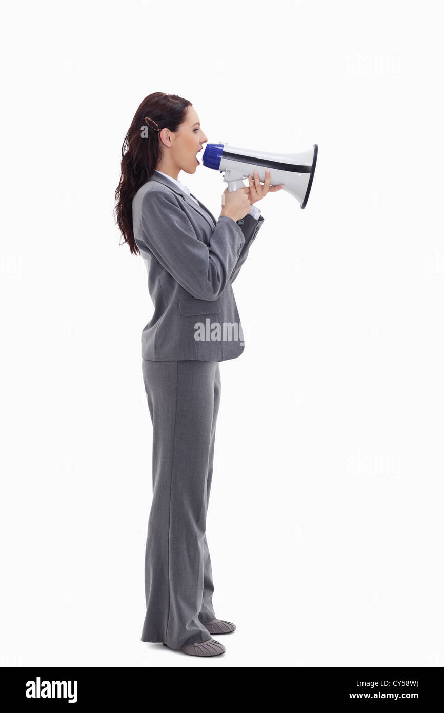 Businesswoman speaking loudly into a megaphone - Stock Image