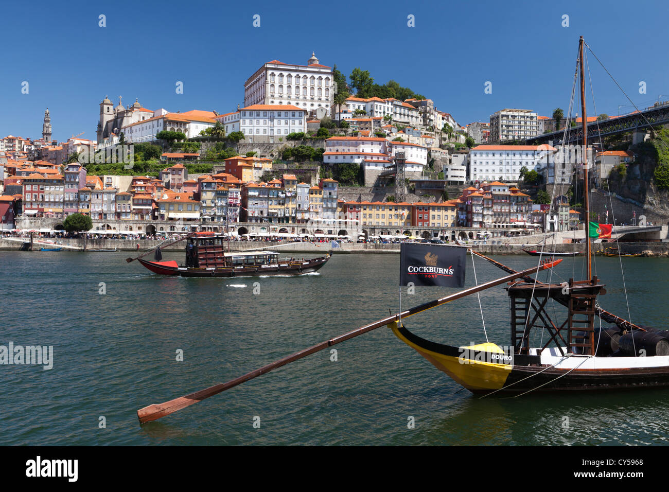 The Douro river, Port wine barges and the historic Ribeira district of Porto (Oporto), Portugal - Stock Image