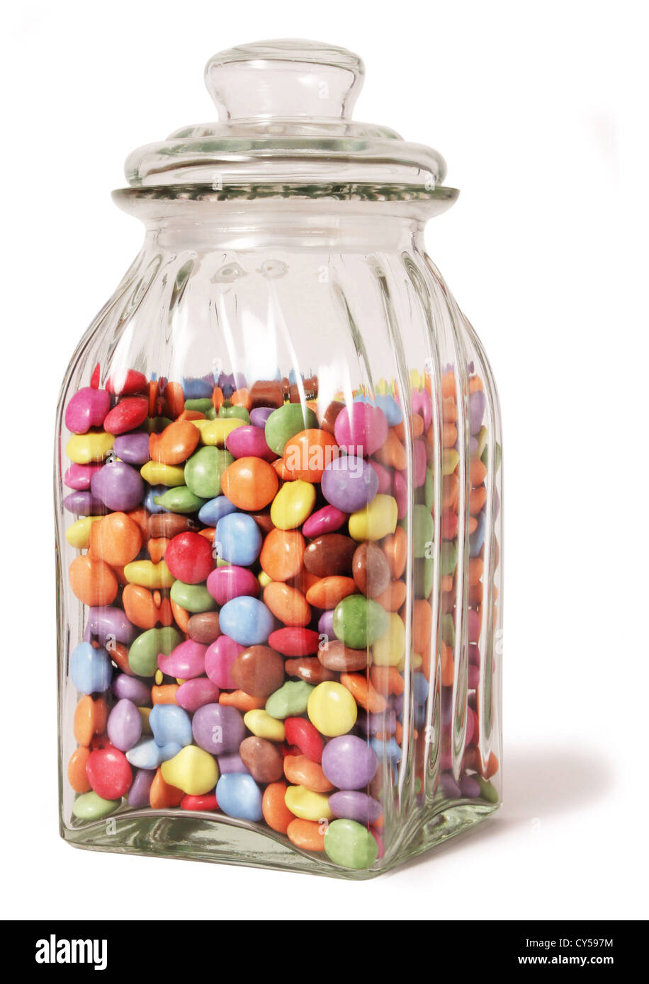 traditional sweet jar full of sweets on a white background ...