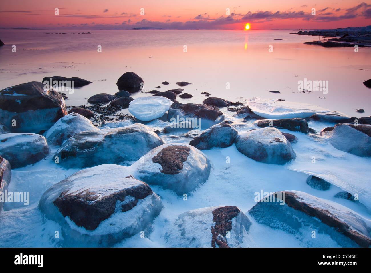 Coastal winter landscape at sunset, at Larkollen in Rygge kommune, Østfold fylke, Norway. Stock Photo