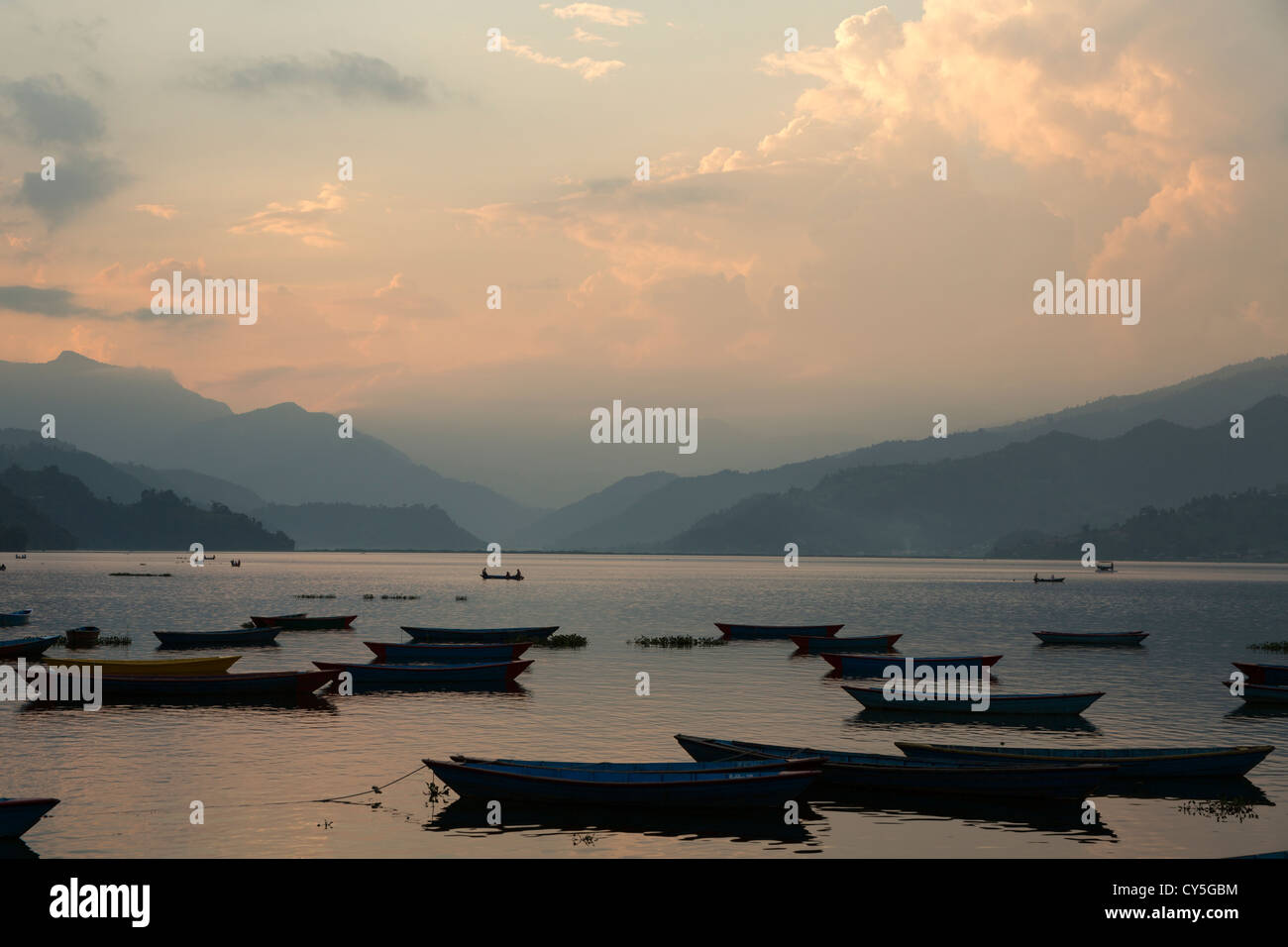 Sunset over Phewa lake in Pokhara, Nepal - Stock Image