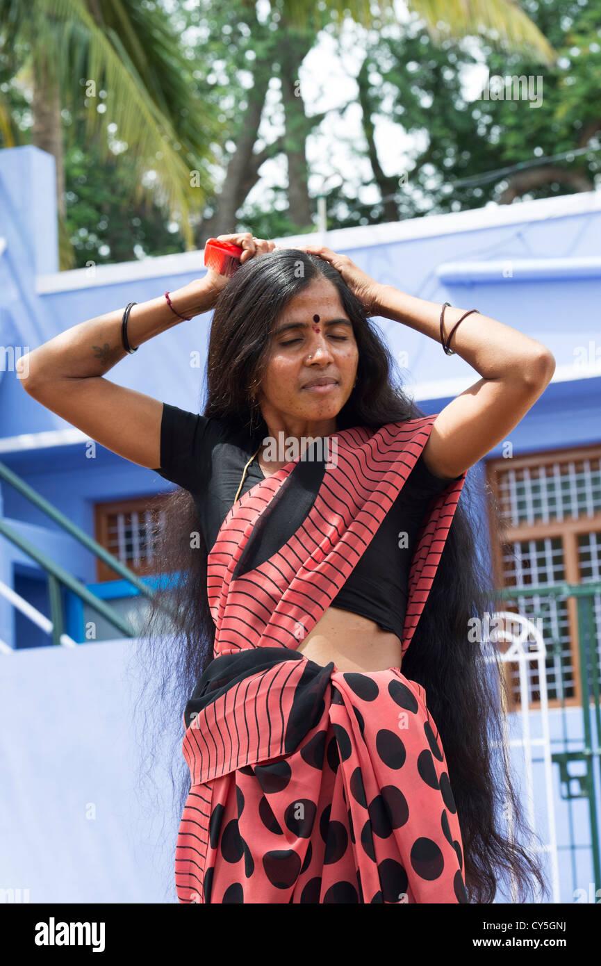 Indian Woman Brushing Her Long Hair In A Rural Indian Village