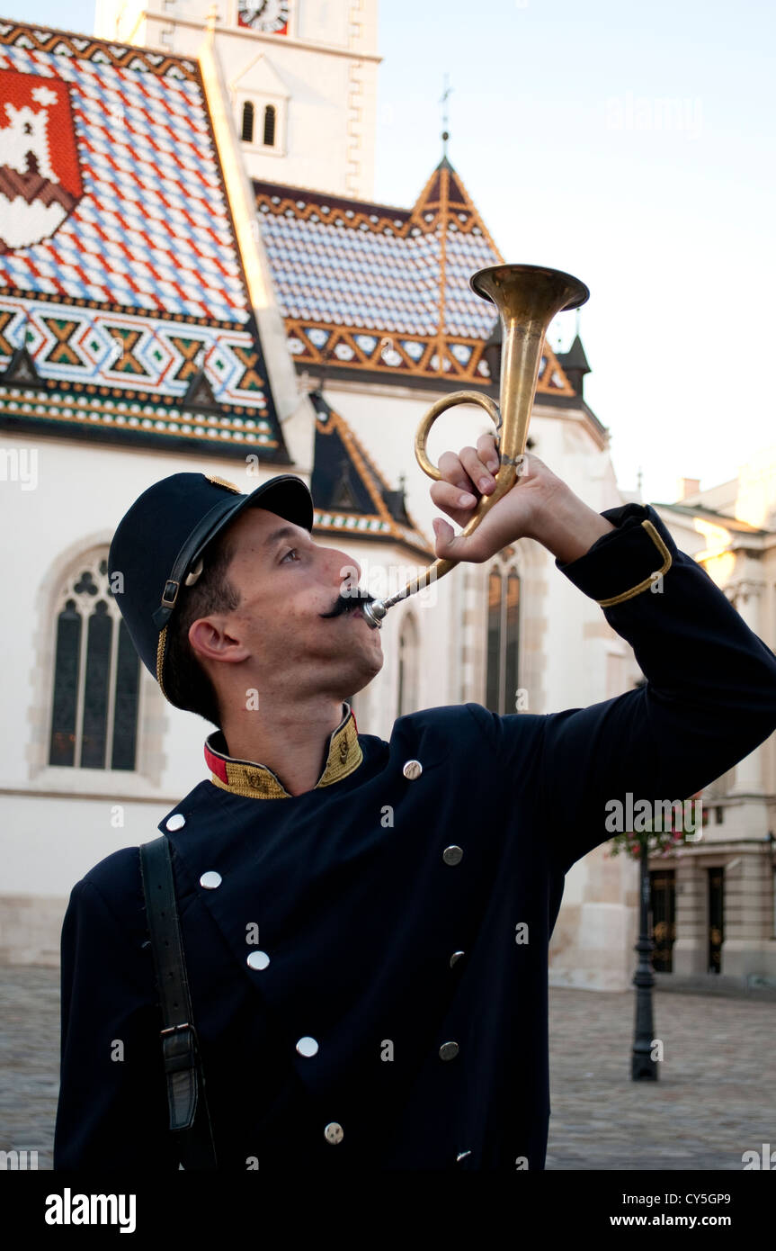 Man blowing a horn on St Mark's Square, Old Town, Zagreb, Croatia - Stock Image