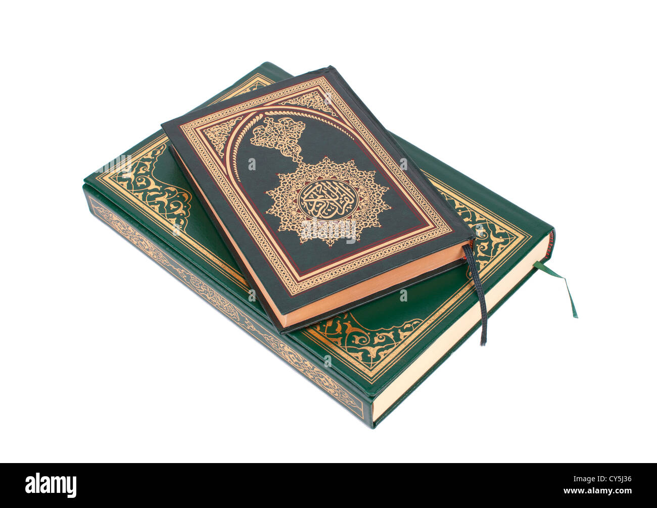 Two Examples of The Holy Quran Isolated On White - Stock Image