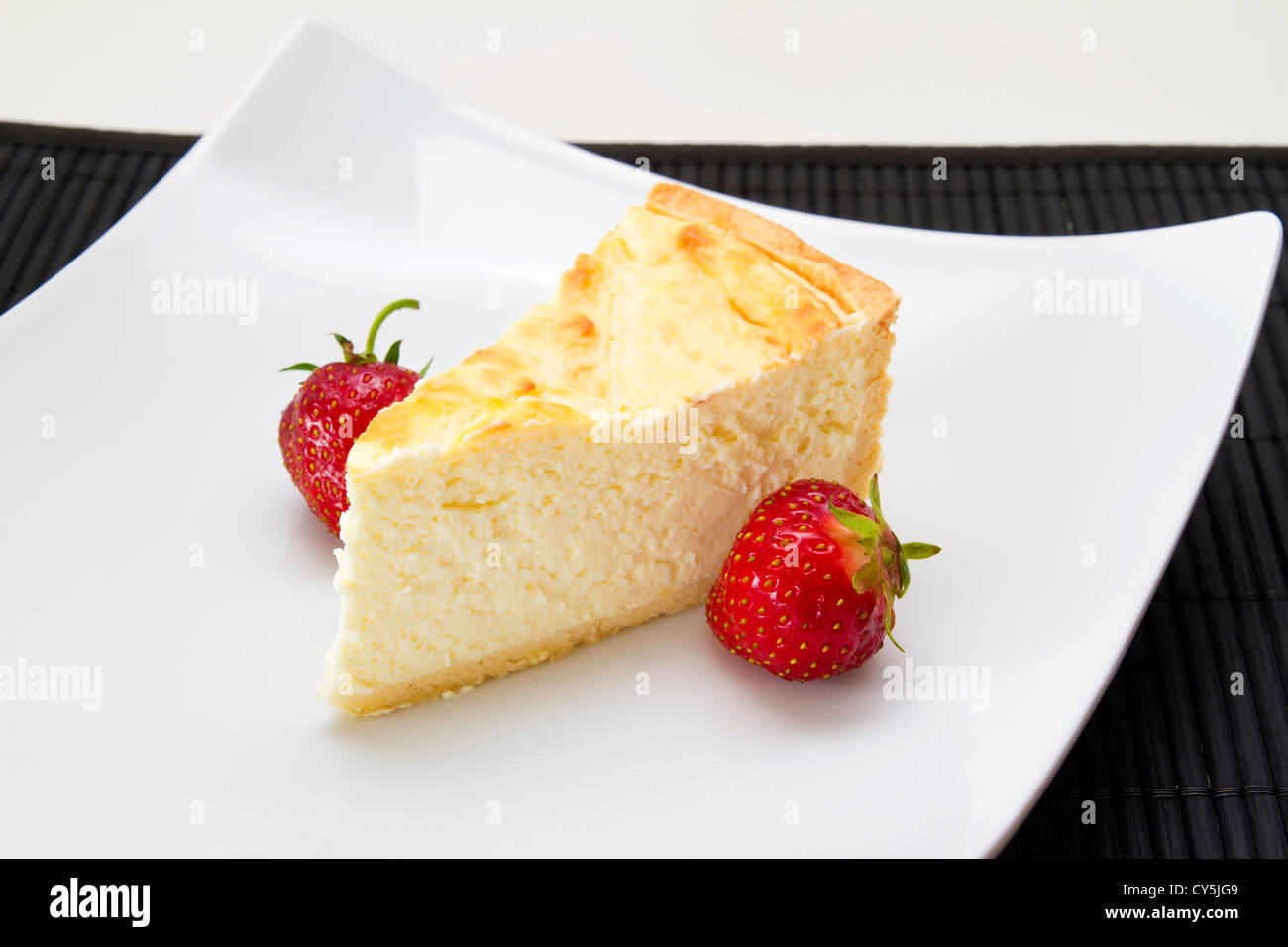 Cheesecake with strawberries and coffee - Stock Image