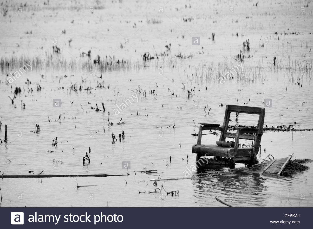 A chair is seen in a flooded rural area caused by cyclone Nargis near Yangon in the Republic of the Union of Myanmar - Stock Image