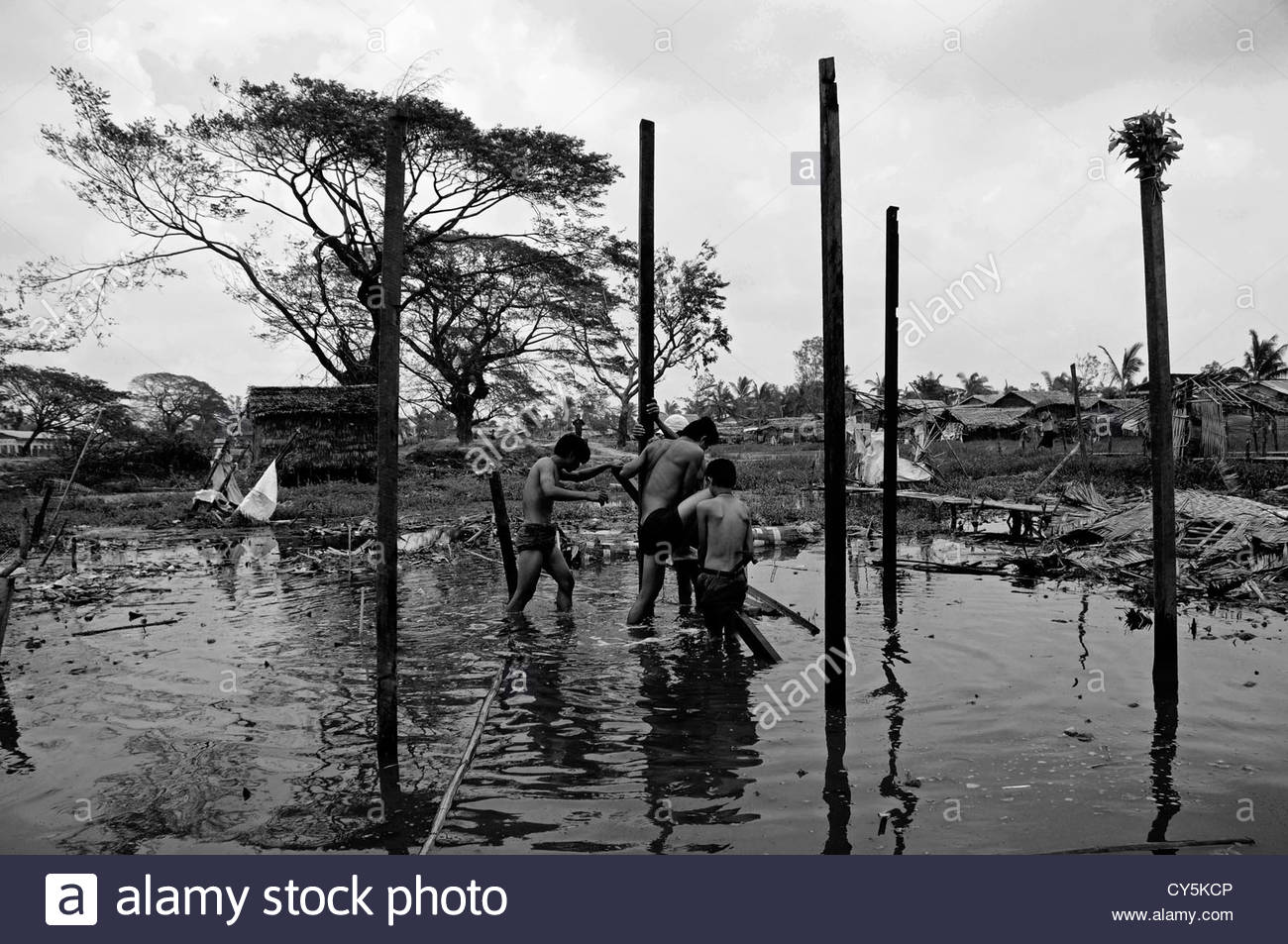 Cyclone Nargis survivors rebuild their flooded house in Hlaing Tharyar township of Yangon in Republic of the Union - Stock Image