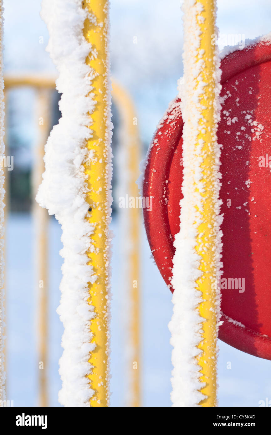 Snow covered playground equipment - Stock Image