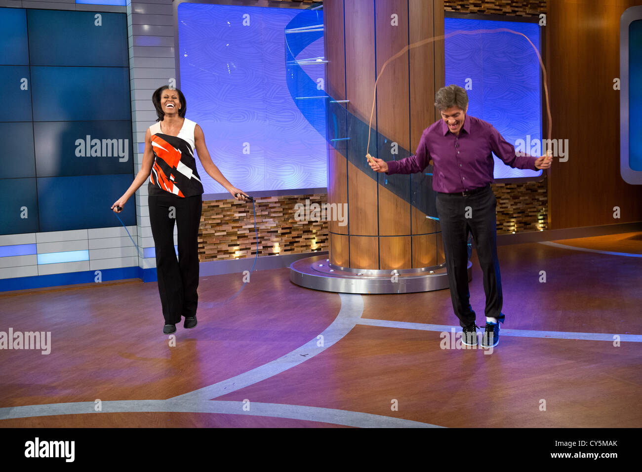 First Lady Michelle Obama and Dr. Mehmet Oz jump rope during a taping of the Dr. Oz Show, at the Dr. Oz Studio August - Stock Image