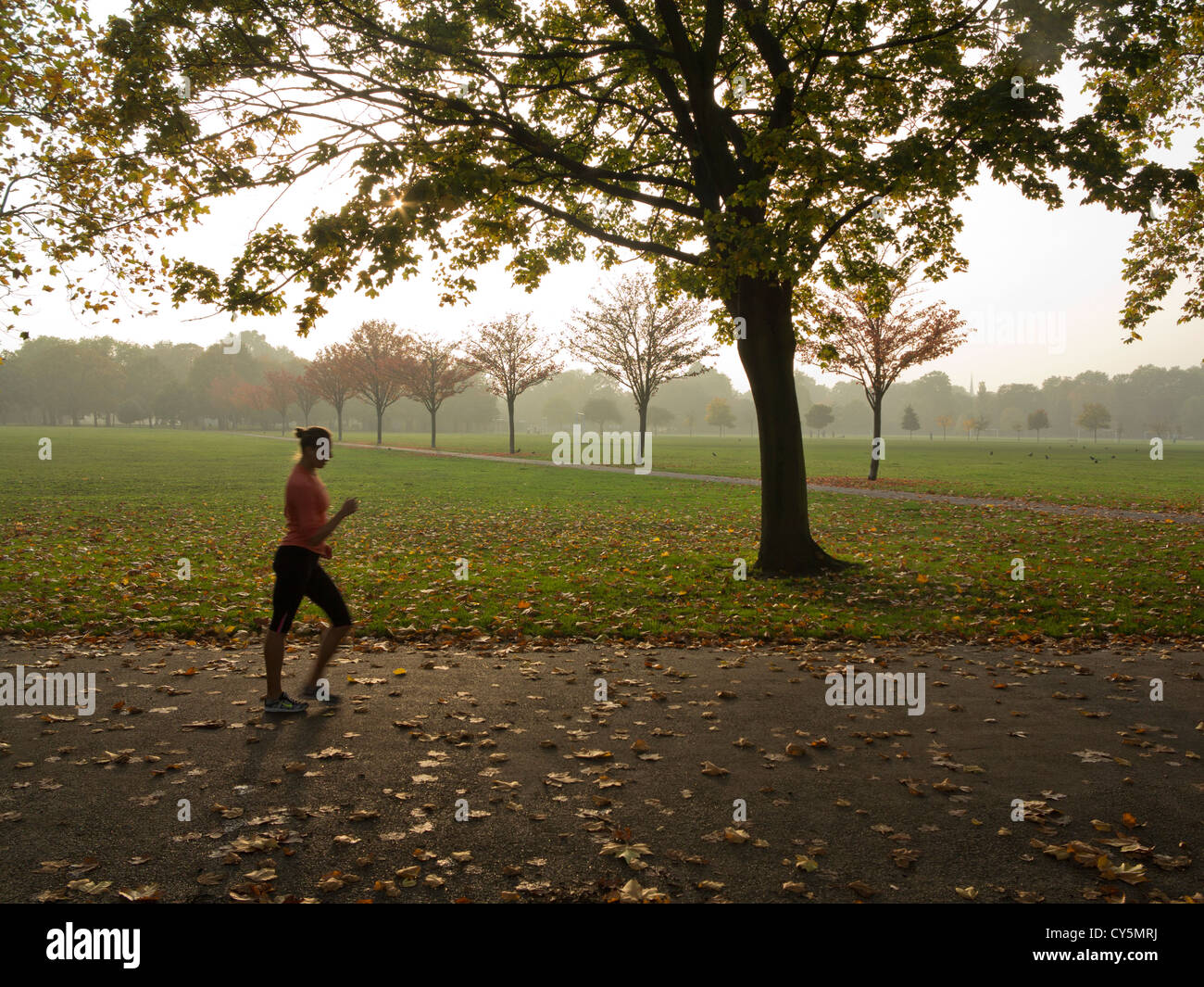 Woman exercises in Victoria Park, London, near 2012 Olympic site, UK - Stock Image