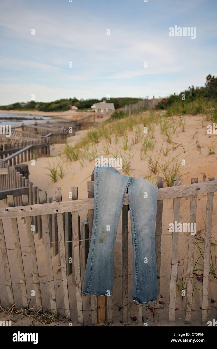 Jeans drying on a fence on Breakwater Beach, Brewster, Cape Cod, Massachusetts - Stock Image