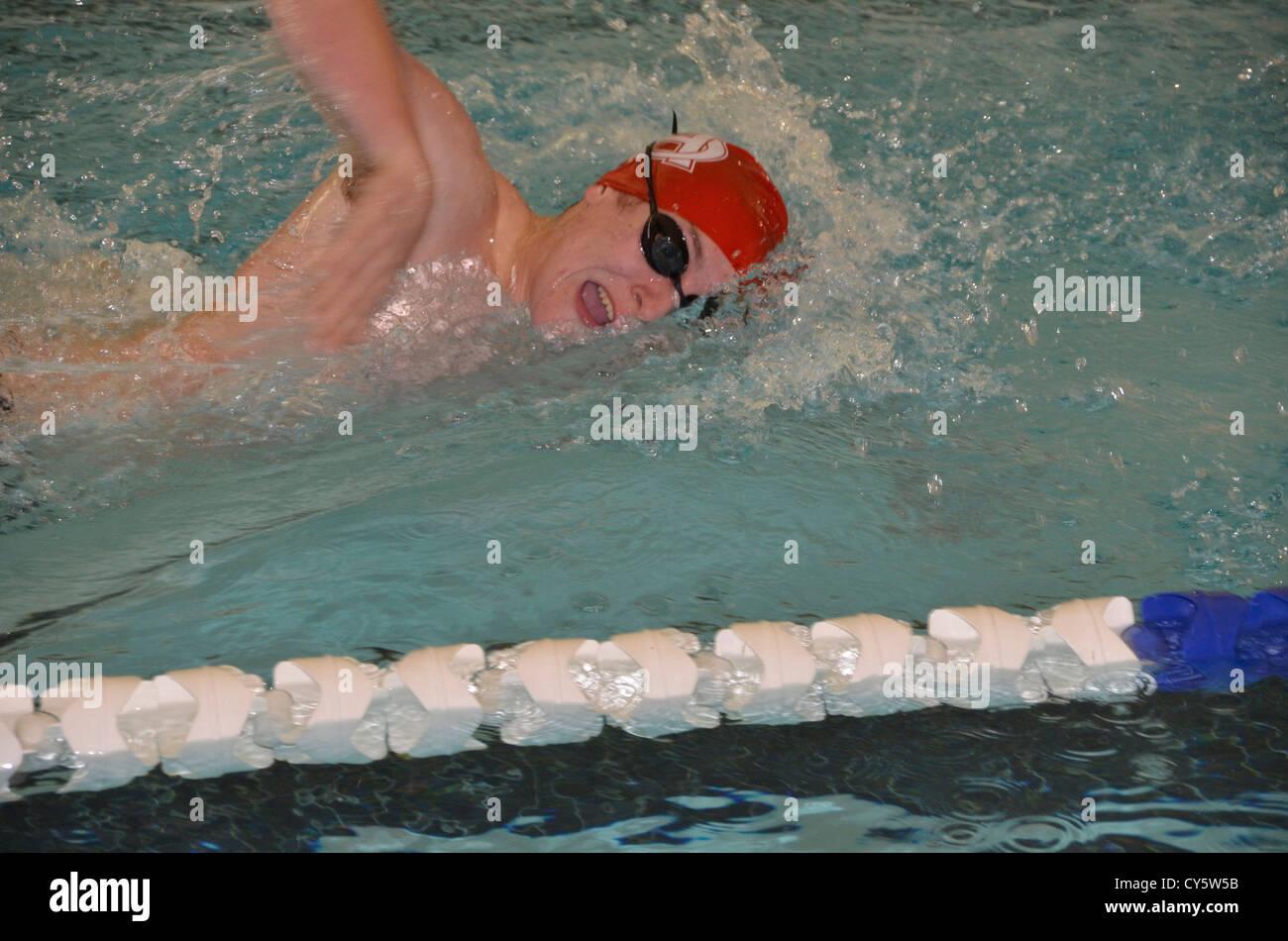 swimmer in swim meet - Stock Image