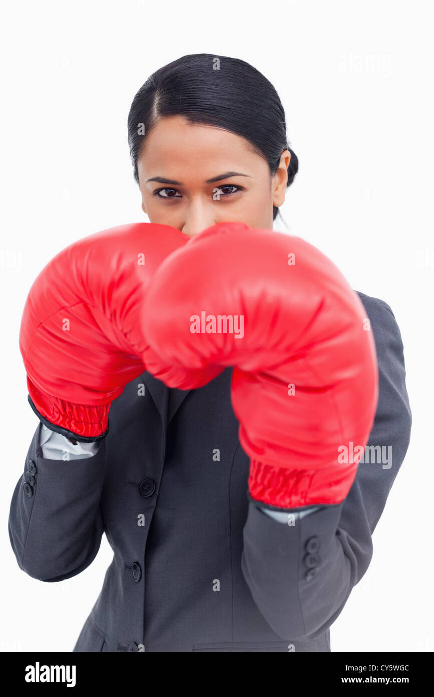Close up of belligerent saleswoman with boxing gloves - Stock Image