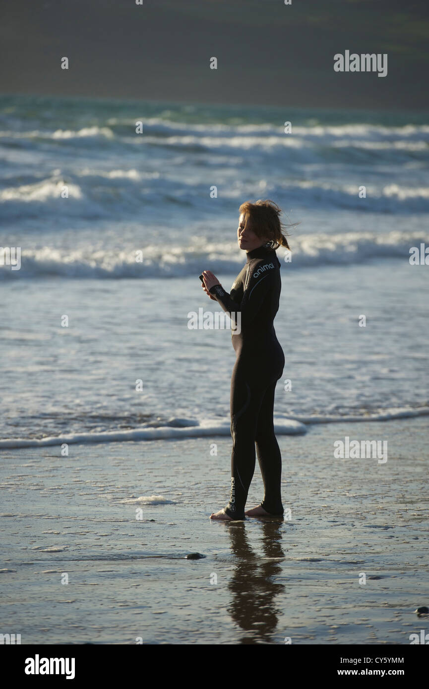 Preparing to surf at Porth Neigwl North Wales - Stock Image