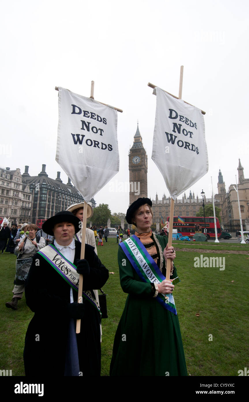 Lobby of Parliament by UK Feminista. Women dressed as suffragettes, holding banners saying 'Deeds not words' - Stock Image