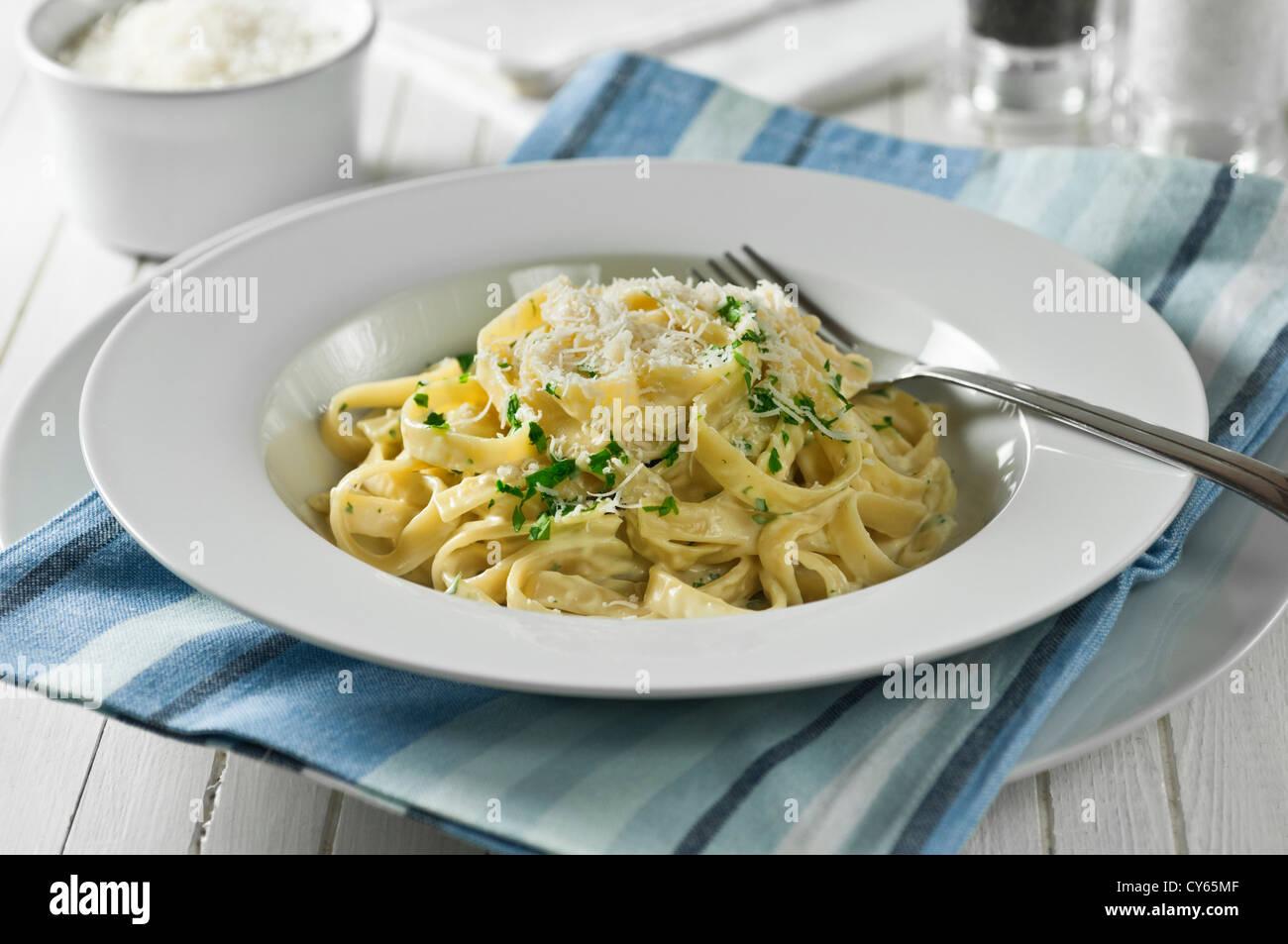 Fettucine Alfredo Pasta and cheese dish - Stock Image