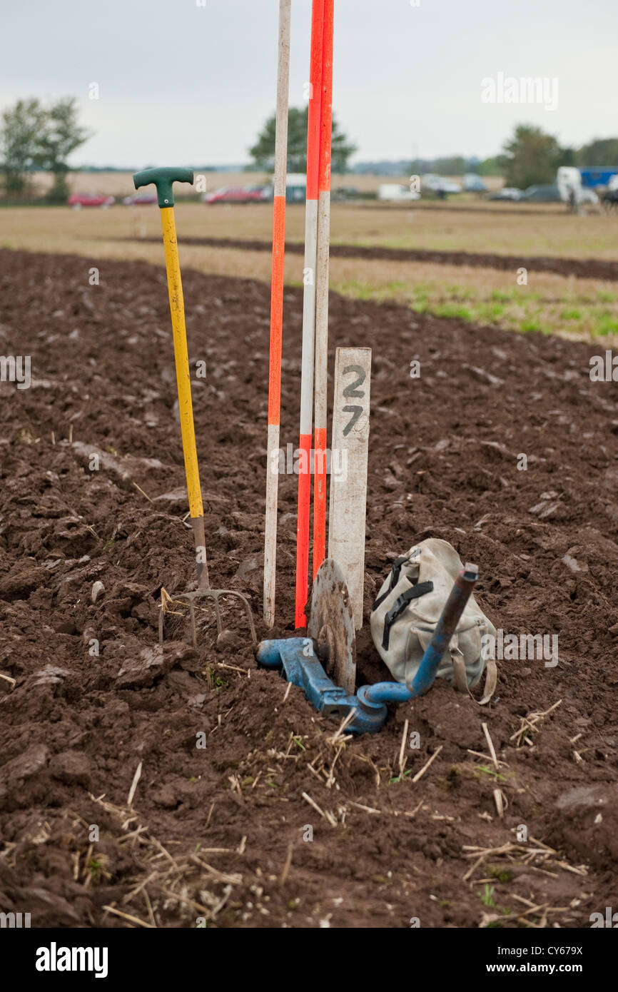 Ploughed soil and markers in field in Perthshire Scotland - Stock Image