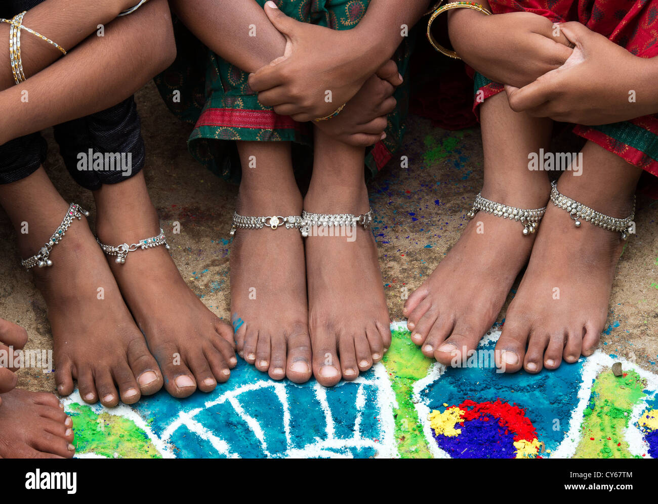 Indian Girls Bare Feet Around A Indian Rangoli Peacock Festival Design Made In Coloured Powder