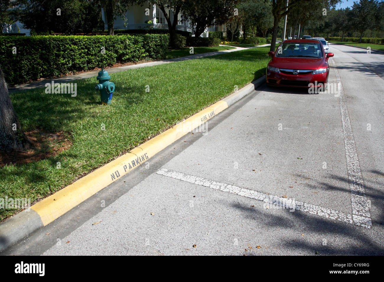 fire hydrant no parking curb in residential area of celebration florida usa - Stock Image