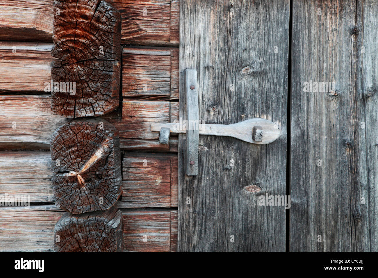 Detail of a traditional log house in Sweden: wooden bolt on a barn door. - Stock Image