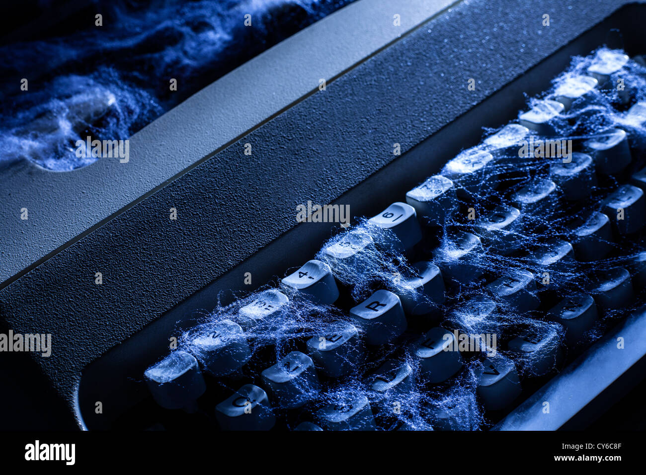 Old Typewriter with Spider Web - Stock Image