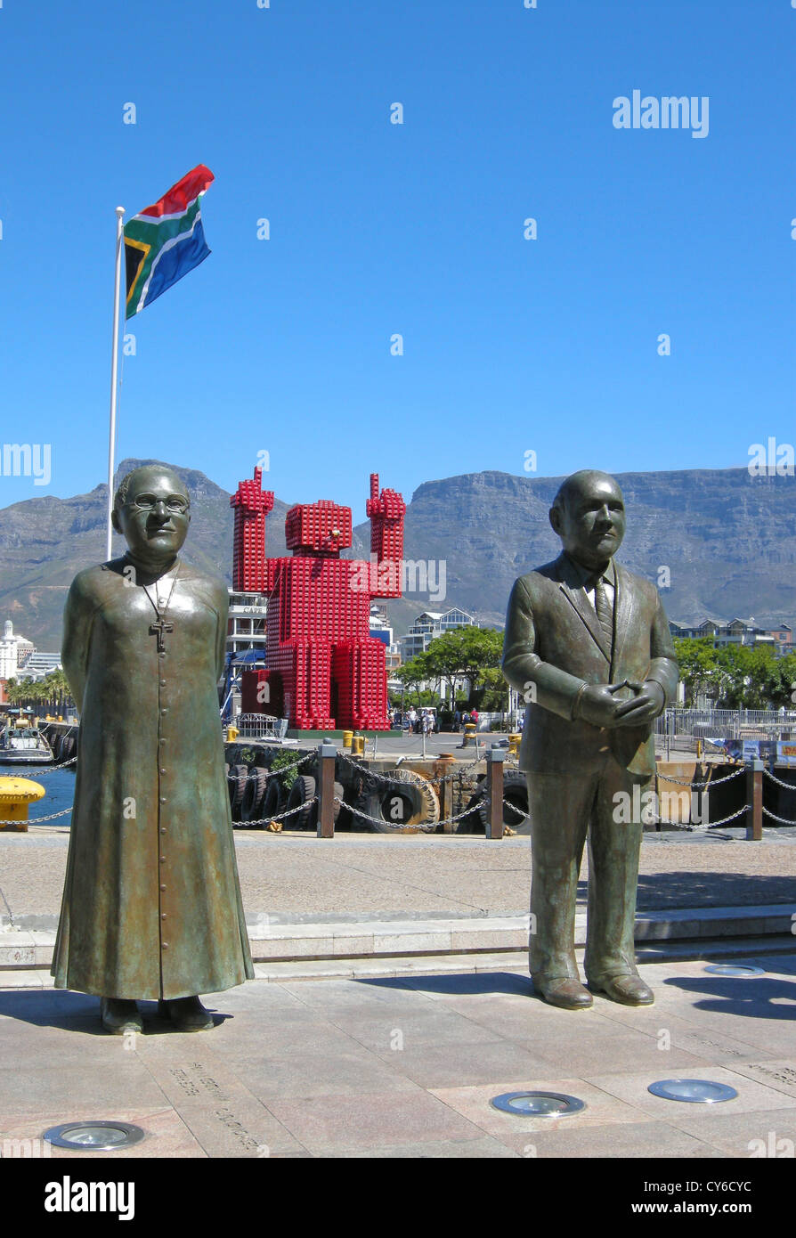 Tutu, Coca Cola man and De Klerk in the port at waterfront of Cape town in South africa with flag of South Africa, - Stock Image