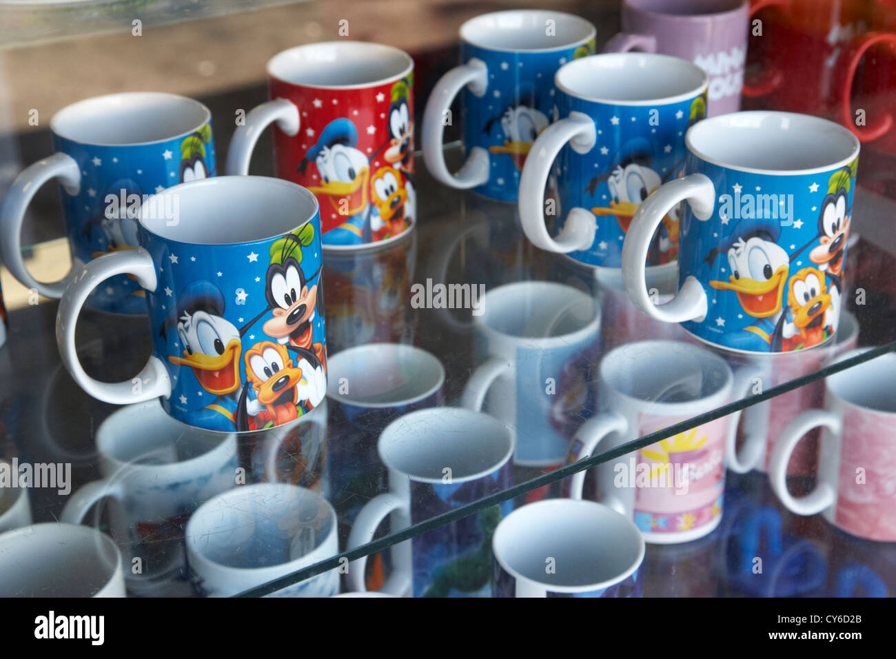 disney character mugs for sale in a souvenir shop florida usa - Stock Image