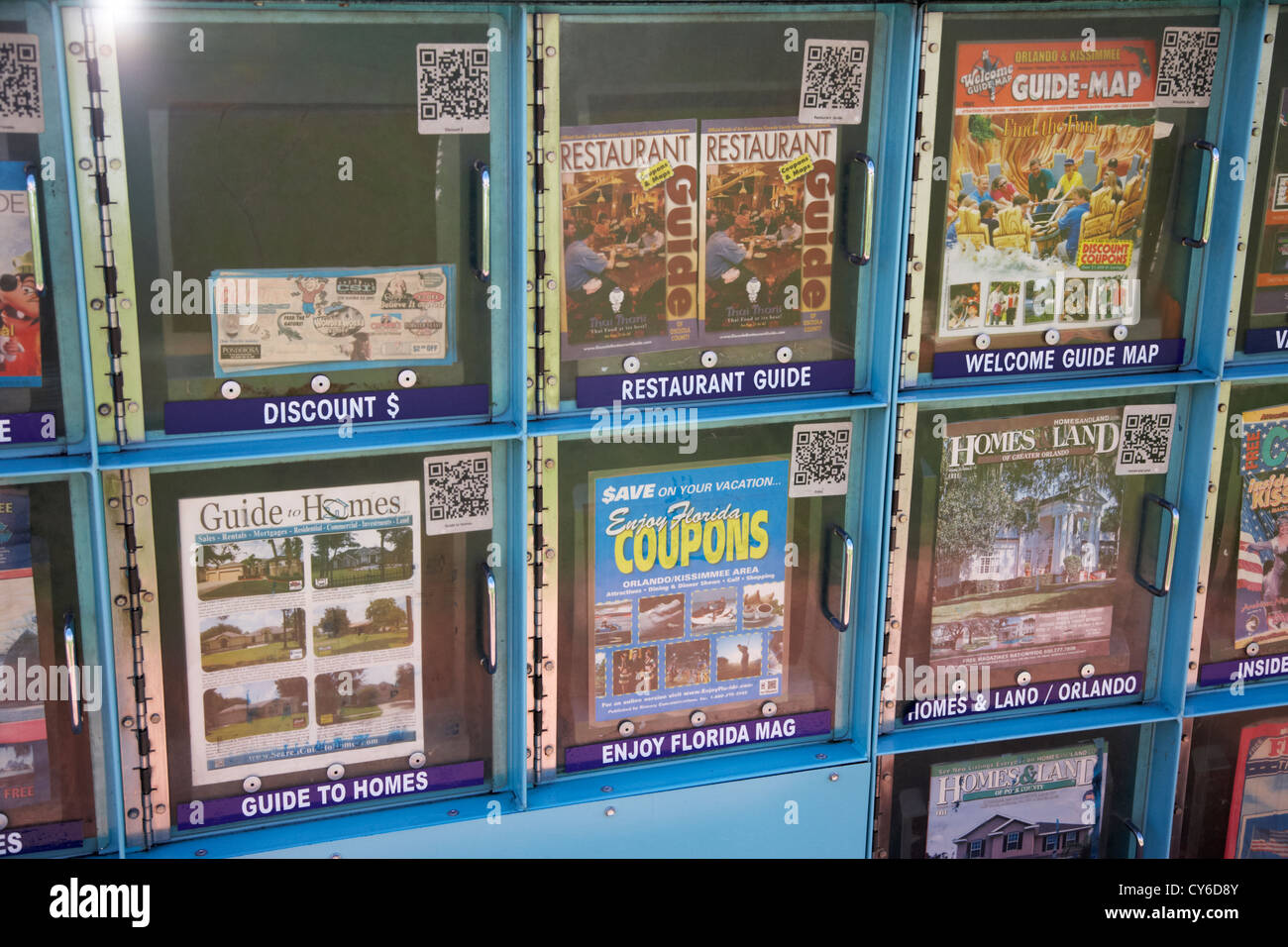 florida discount coupon books guides maps guide dispensers kissimmee florida usa - Stock Image