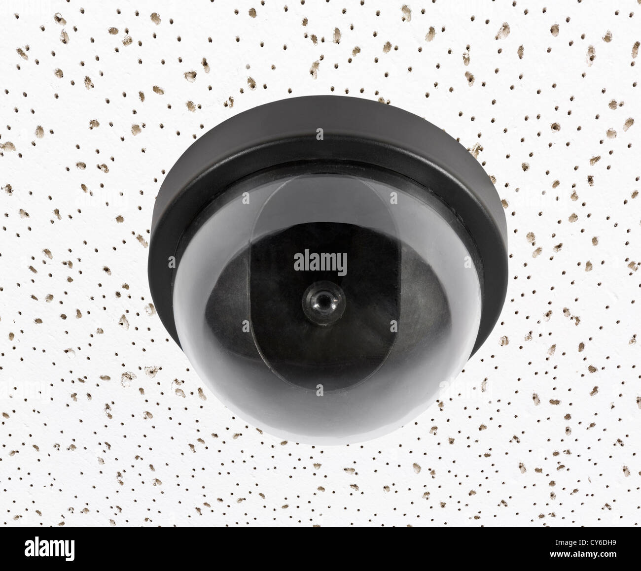Security video surveillance camera globe on acoustic tile ceiling. - Stock Image