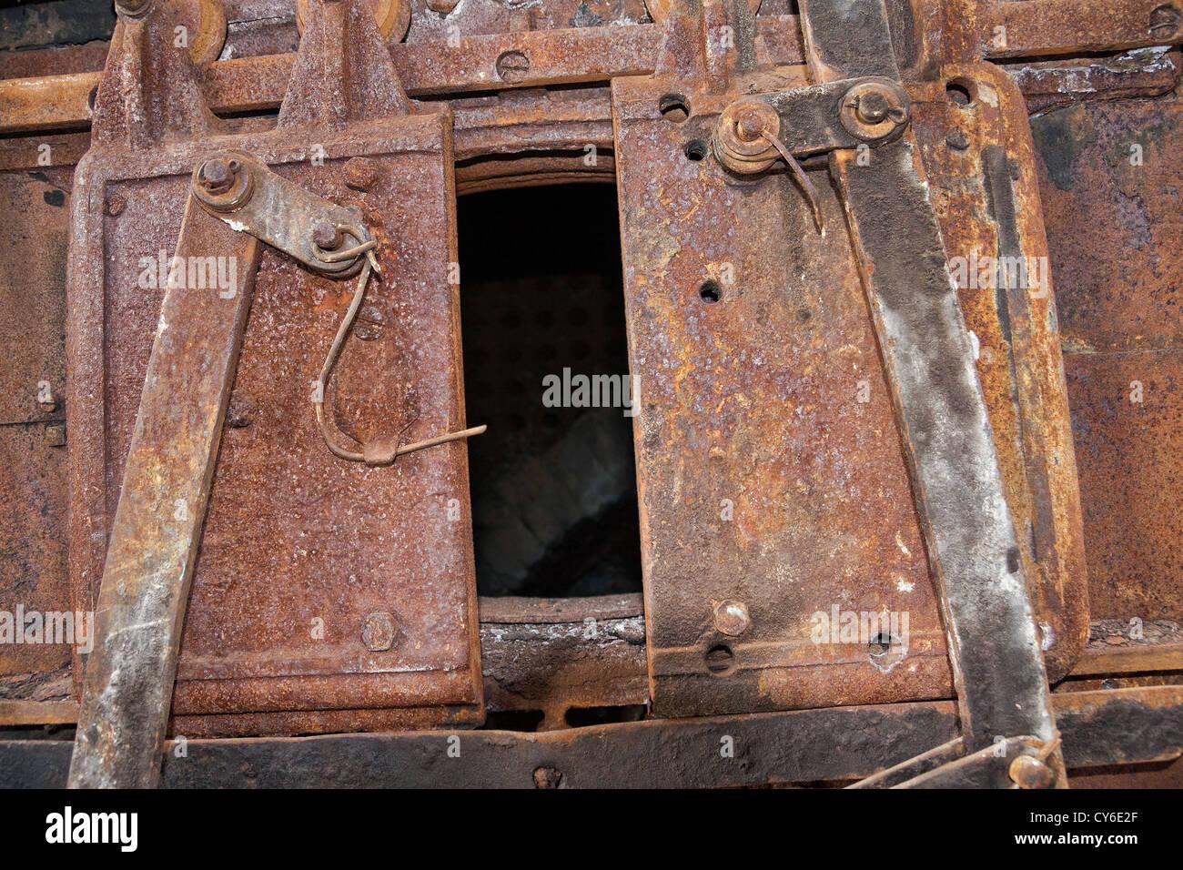 The door of the old rusty locomotive boiler & The door of the old rusty locomotive boiler Stock Photo: 51159207 ...