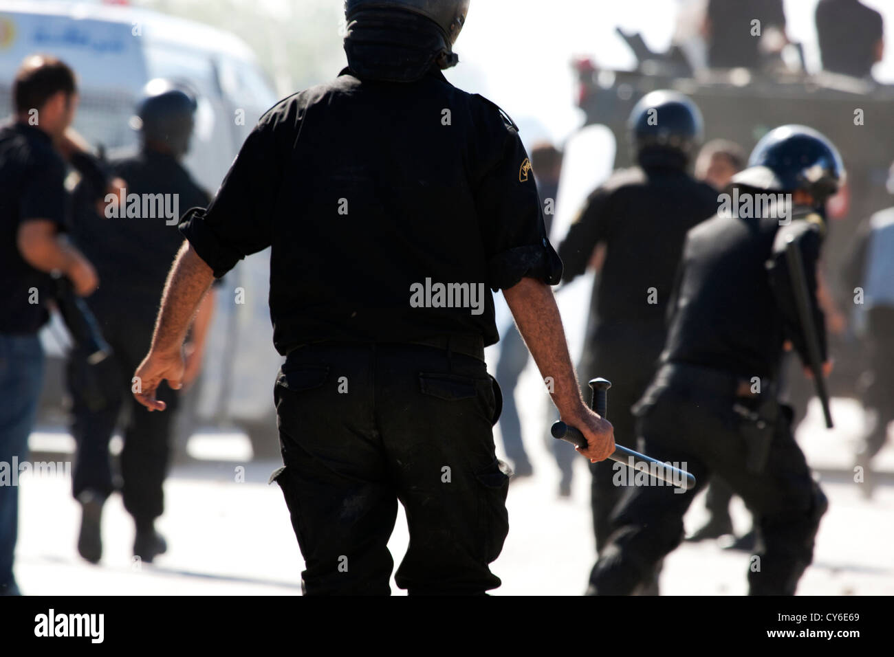 Tunisian riot police charge protesters during violent riots that led to the storming of the US embassy in Tunisia - Stock Image