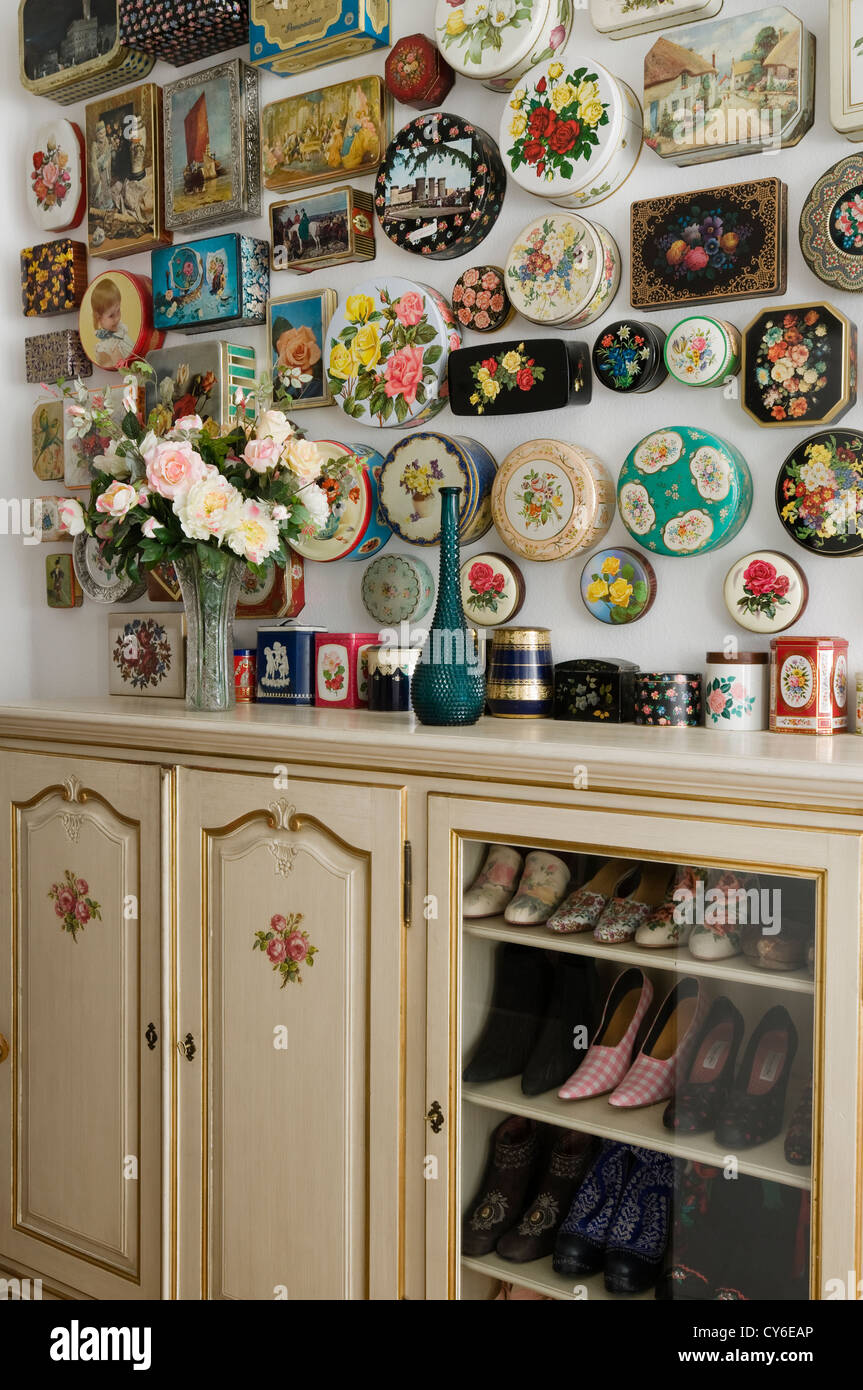Collection of cake tins above sideboard unit - Stock Image