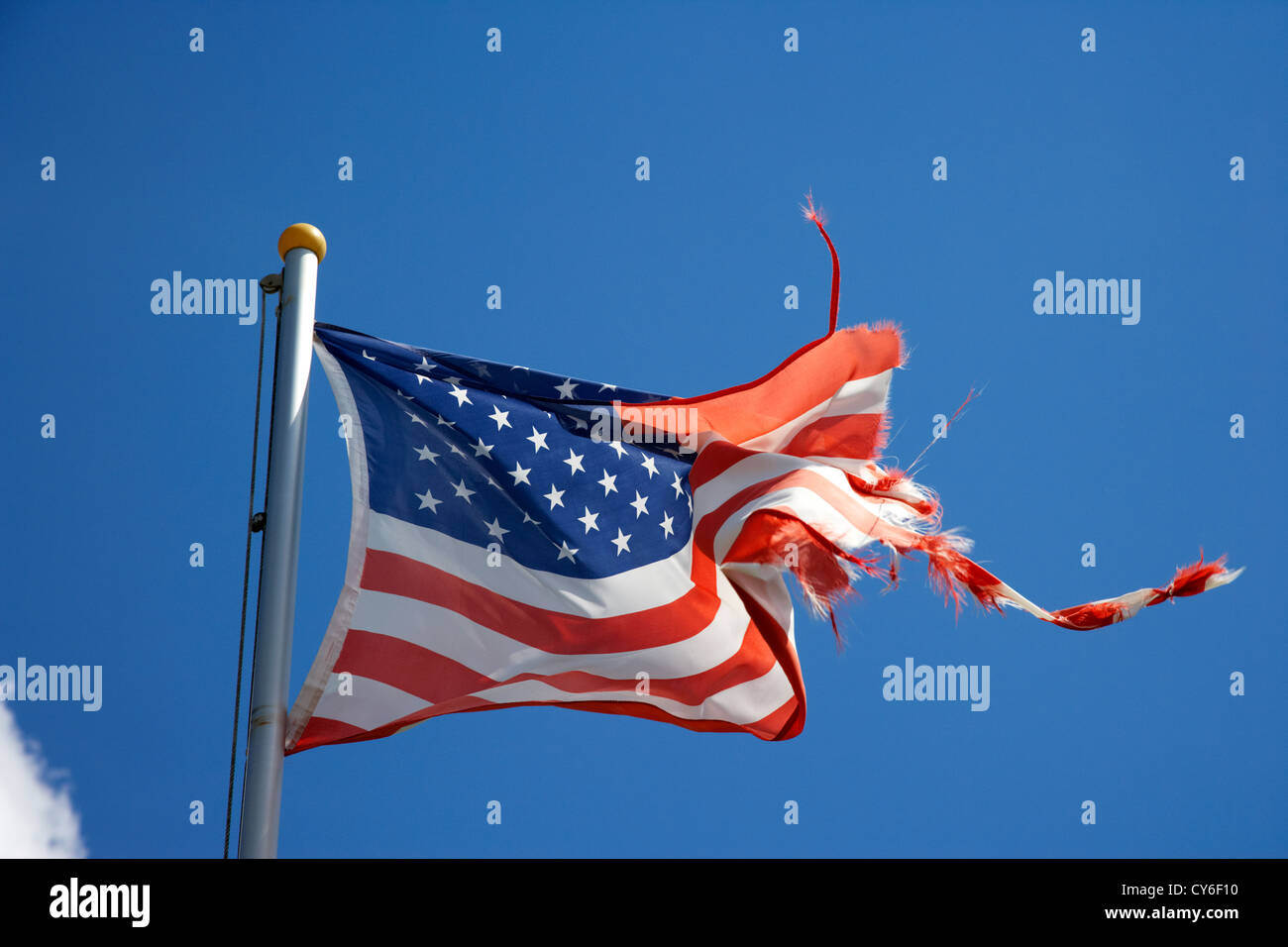 torn ragged us stars stripes flag flying american - Stock Image