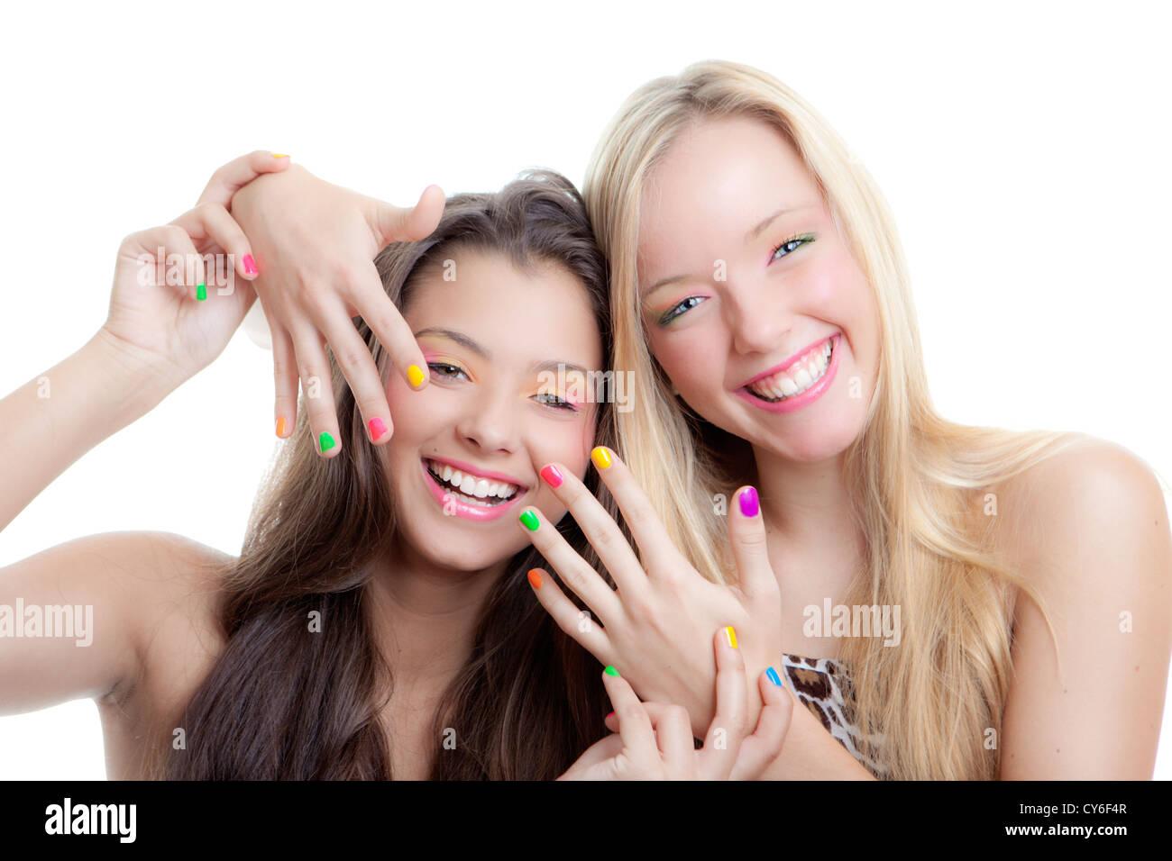 teens nails, young girls with bright make up and nail varnish - Stock Image